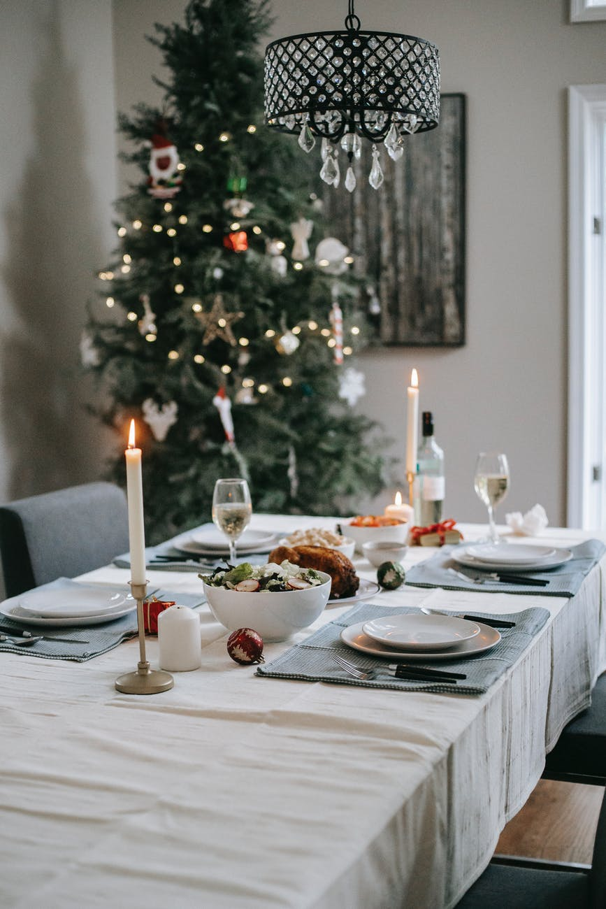 served table with tasty food near christmas tree at home
